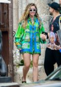 Miley Cyrus rocks a colorful shirt as she heads to hop on private jet in Miami, Florida