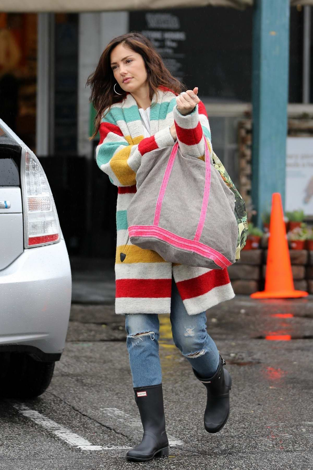 Minka Kelly looks lovely in a colorful jacket while shopping groceries at Whole Foods in West Hollywood, Los Angeles
