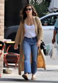 Minka Kelly wore a white top, blue jeans and beige duster while out to lunch in Los Feliz, California