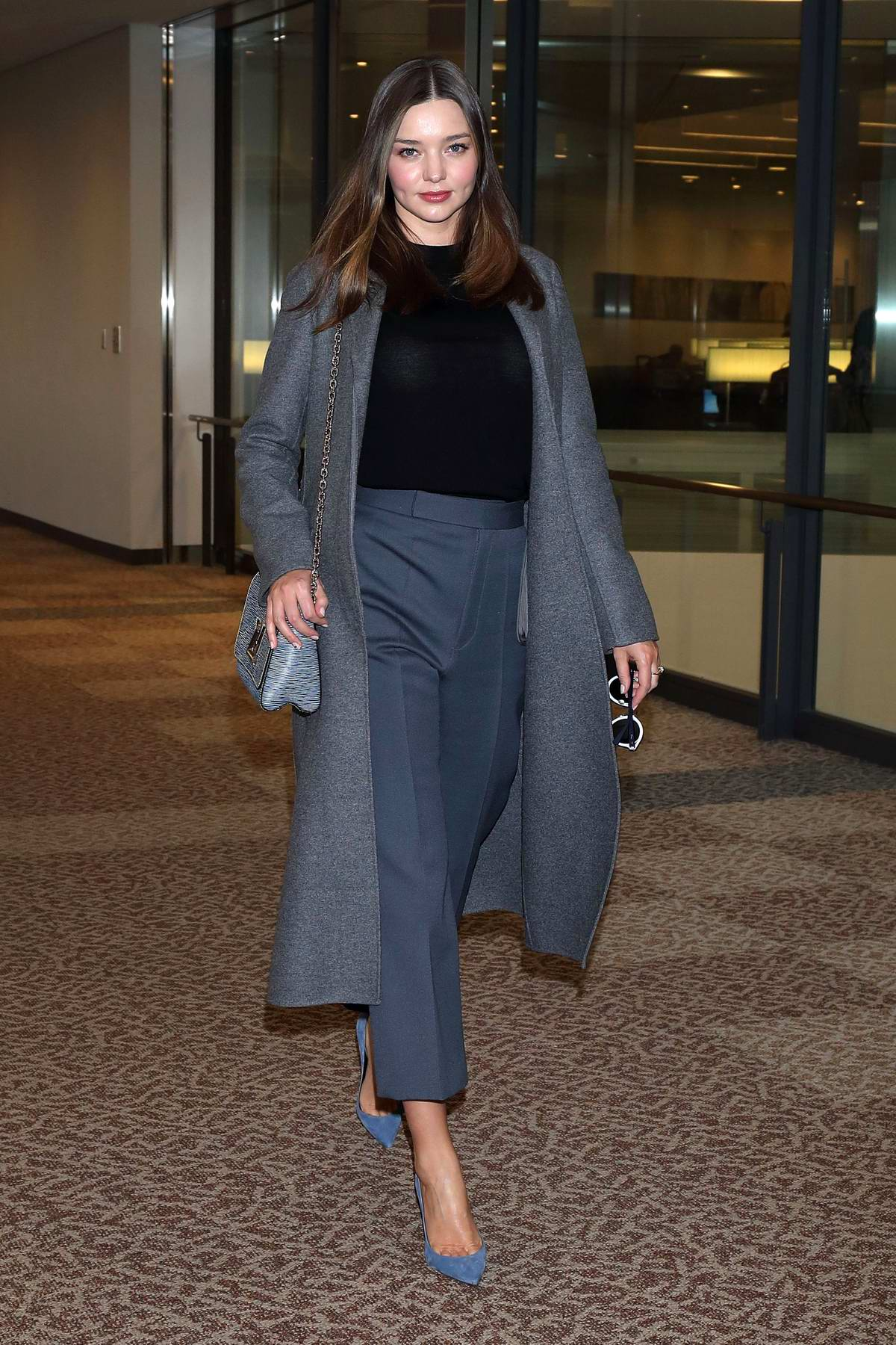 Miranda Kerr looks chic as she arrives at Narita International Airport in Tokyo, Japan