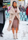 Nicole Scherzinger seen wearing a brown leather dress with a beige trench coat while visiting AOL Build Series in New York City