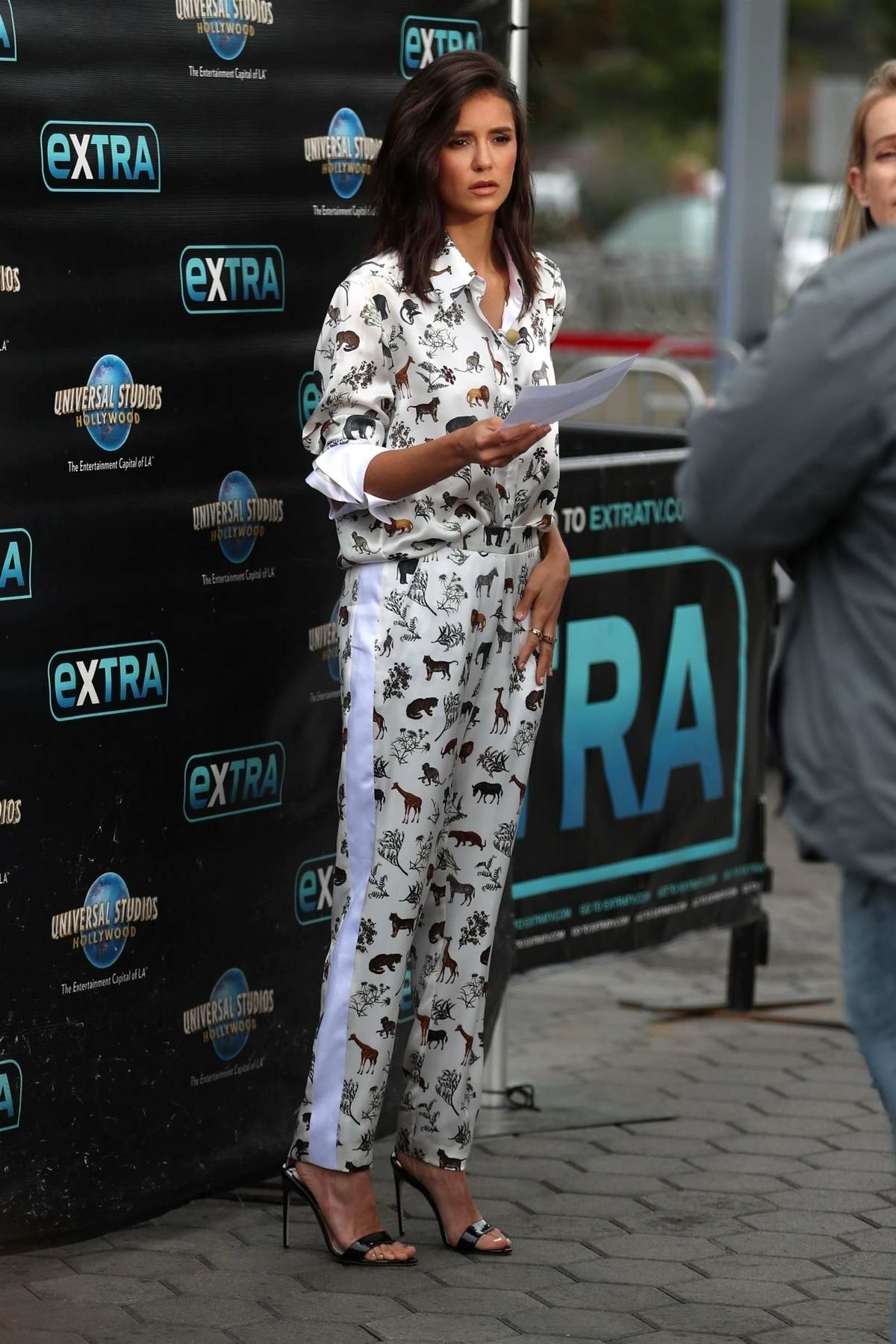 Nina Dobrev makes an appearance on 'EXTRA' at Universal Studios in Universal City, California