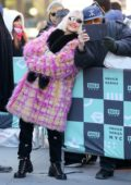 Noomi Rapace spotted in a colorful fur coat as she take selfies with her fans outside AOL Build Studio in New York City