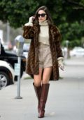 Olivia Culpo looks super stylish in a Fendi fur coat paired with a beige turtleneck, plaid shorts and brown boots while out in Los Angeles