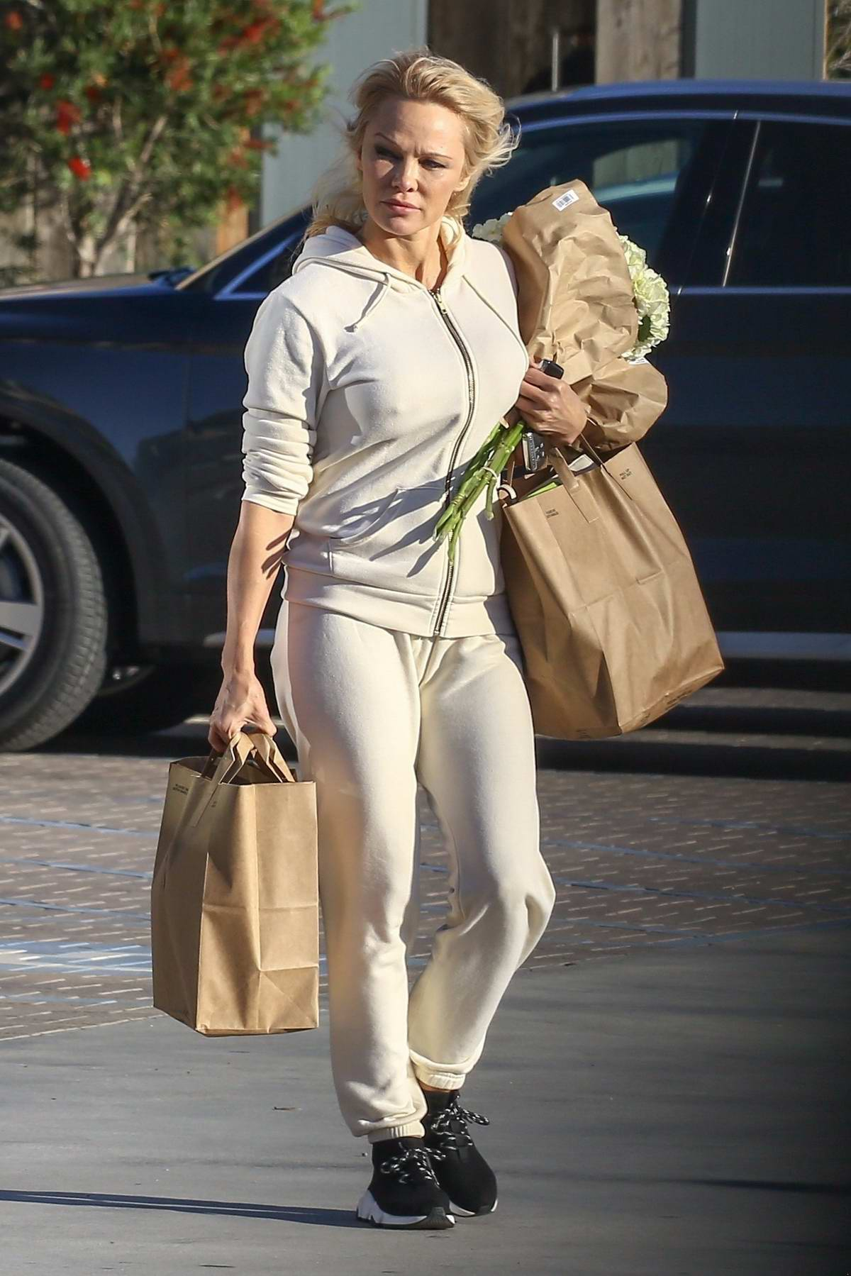 Pamela Anderson wears her workout sweats to shop for groceries at Vintage Grocers market in Malibu, California