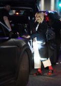 Rita Ora is all smiles as she jets out of LAX in Los Angeles