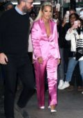 Rita Ora wears a pink pantsuit as she heads for an appearance in New York City
