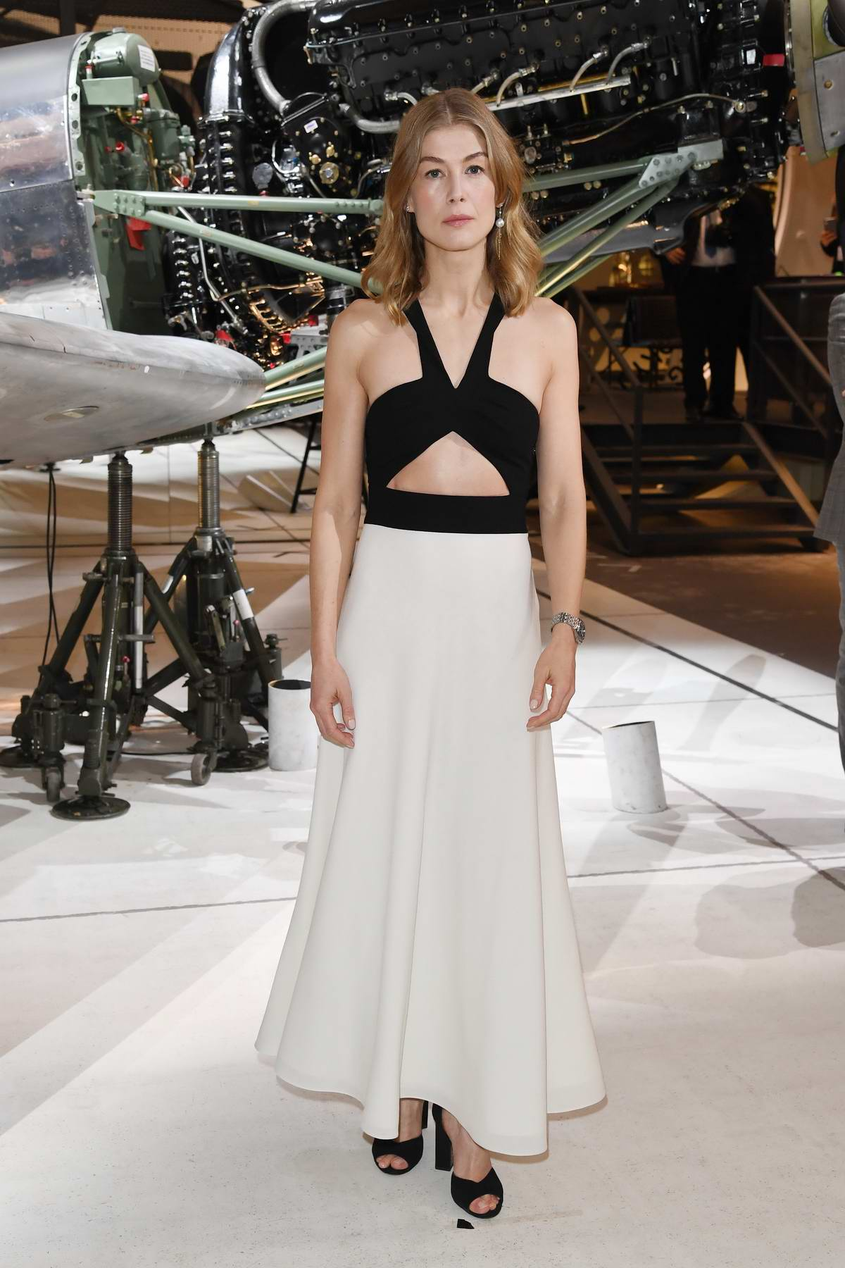 Rosamund Pike visits the IWC booth during the Maison's launch of its new Pilot's Watches at the SIHH in Geneva, Switzerland