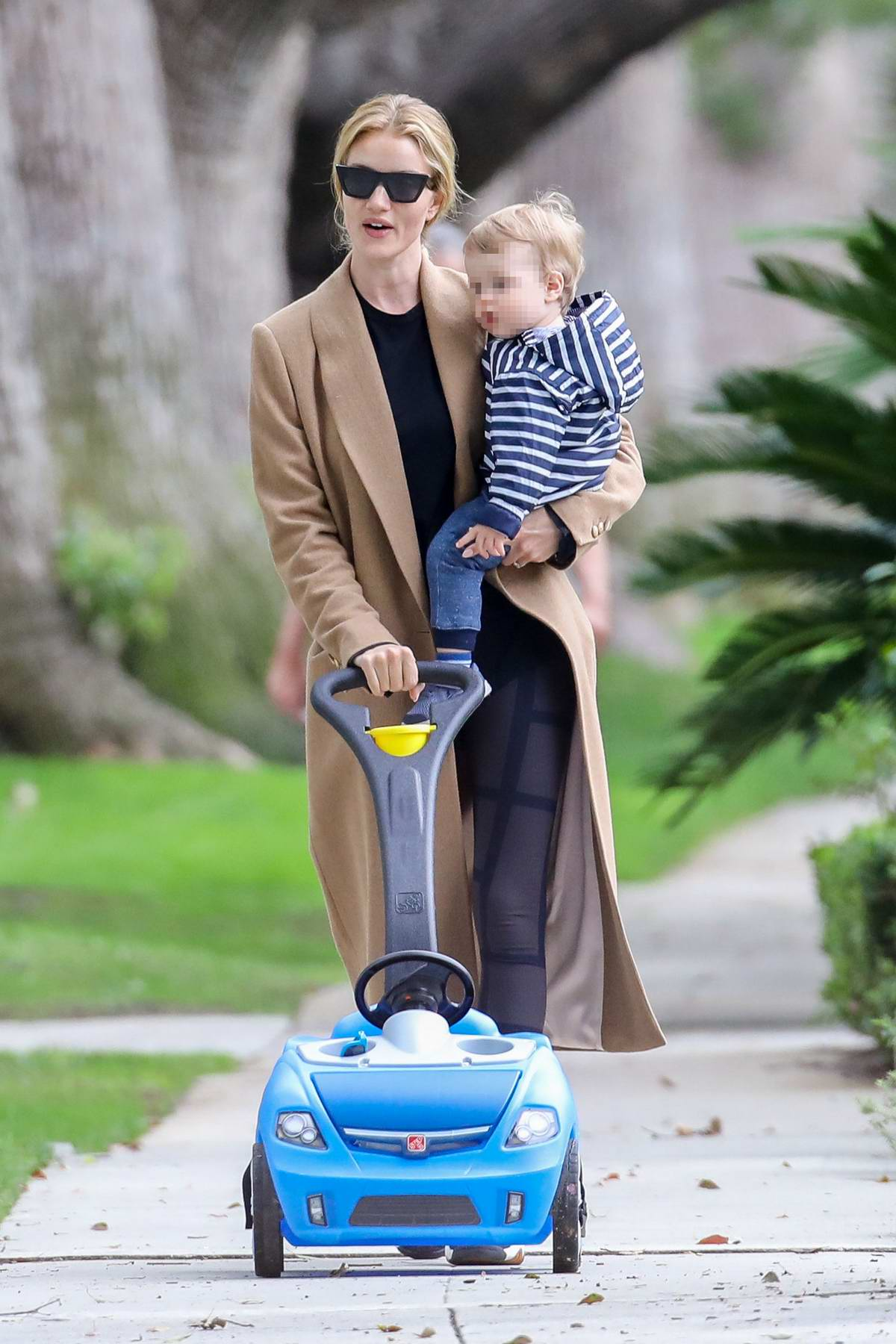 Rosie Huntington-Whiteley takes her son Jack for a stroll in Los Angeles
