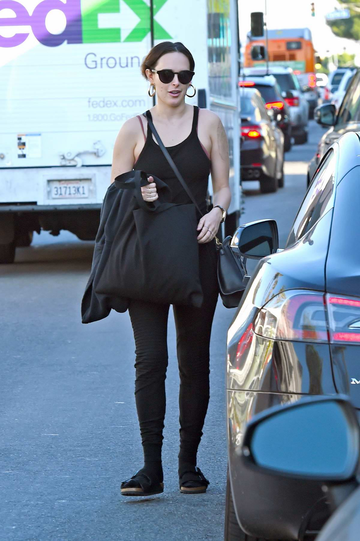 Rumer Willis wears a black tank top with matching black leggings while out in Los Angeles