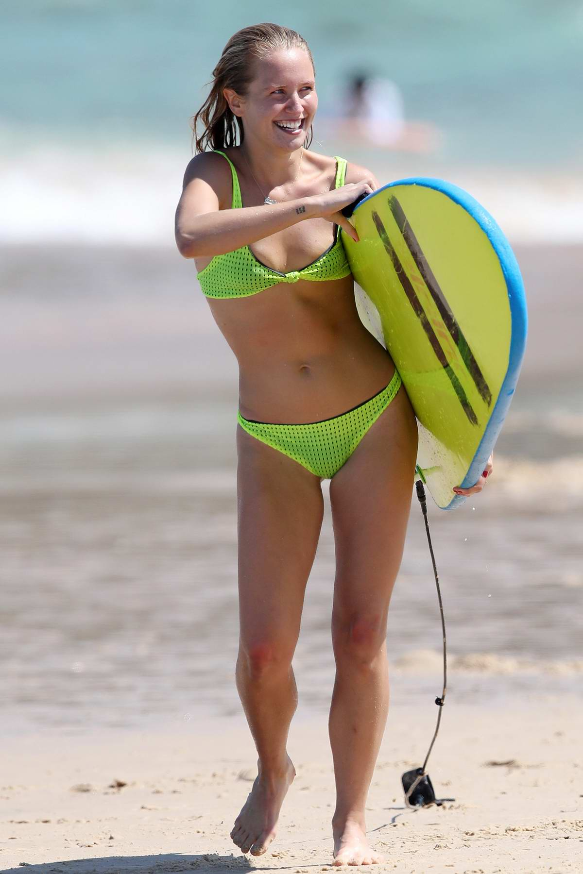 Sailor Brinkley-Cook enjoys a day of surfing in a neon green bikini at Bondi beach in Sydney, Australia