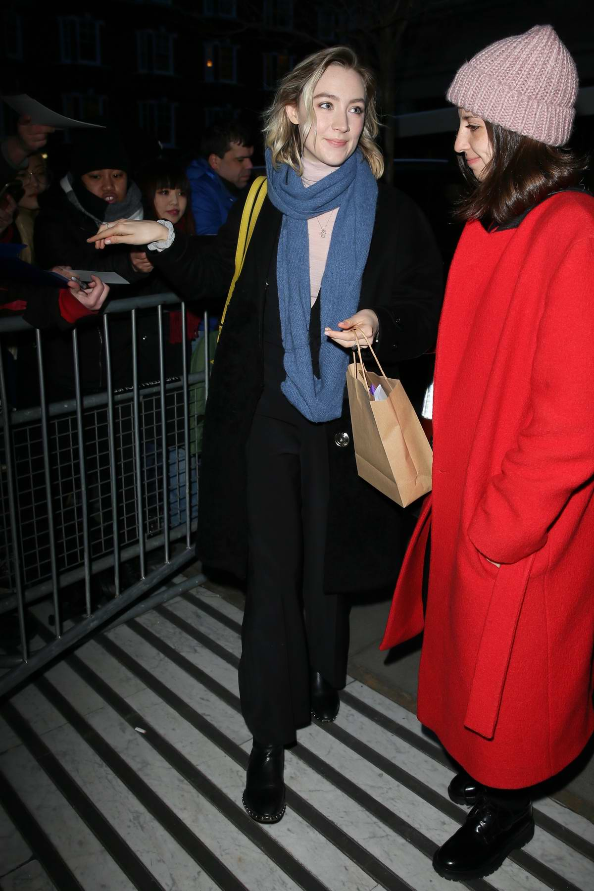 Saoirse Ronan greets fans and sign autographs as she at BBC Radio 2 in London, UK