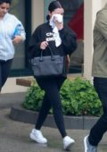 Selena Gomez covers her face as she leaves the gym after a pilates session in Los Angeles