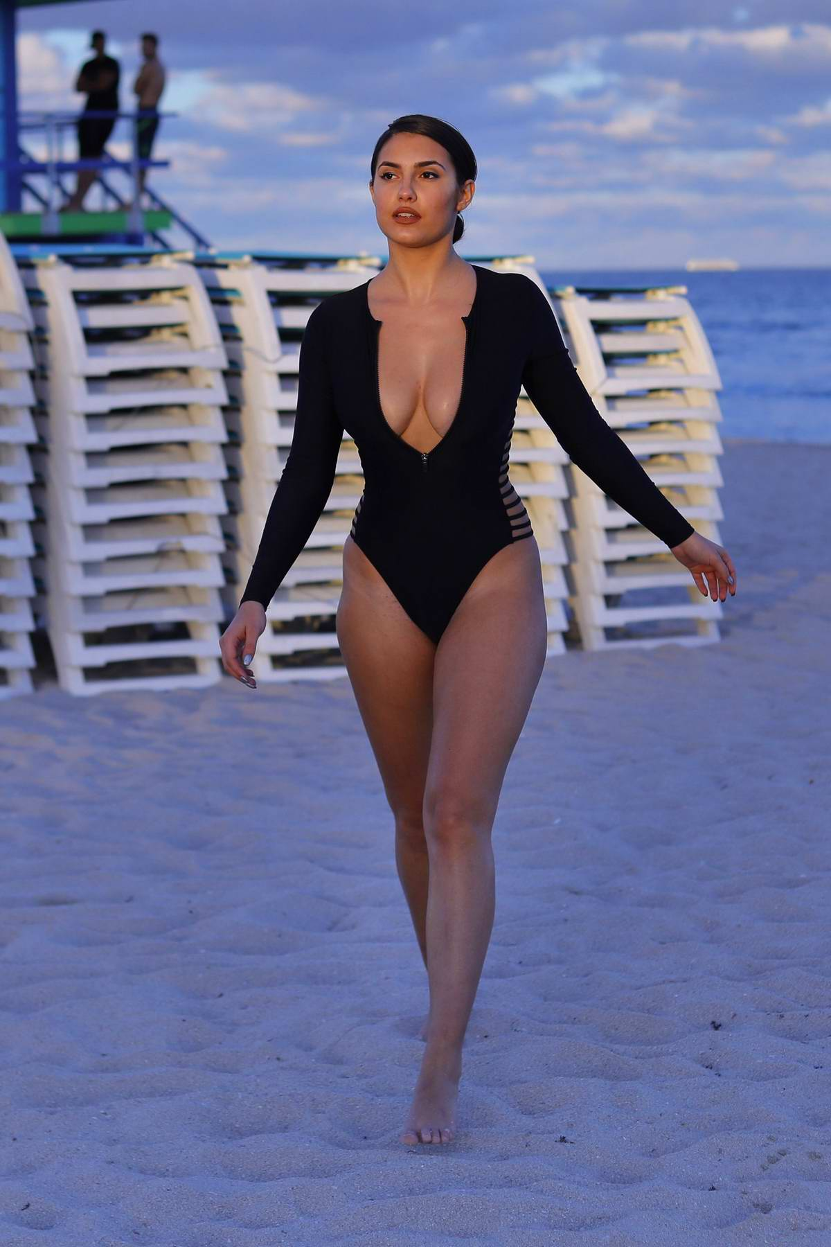 Tao Wickrath sizzles in a plunging black swimsuit during a beach outing in Miami, Florida