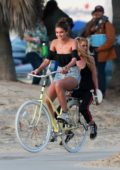 Taylor Hill and Stella Maxwell have a good time during a photo shoot for Victoria's Secret in Venice Beach, California