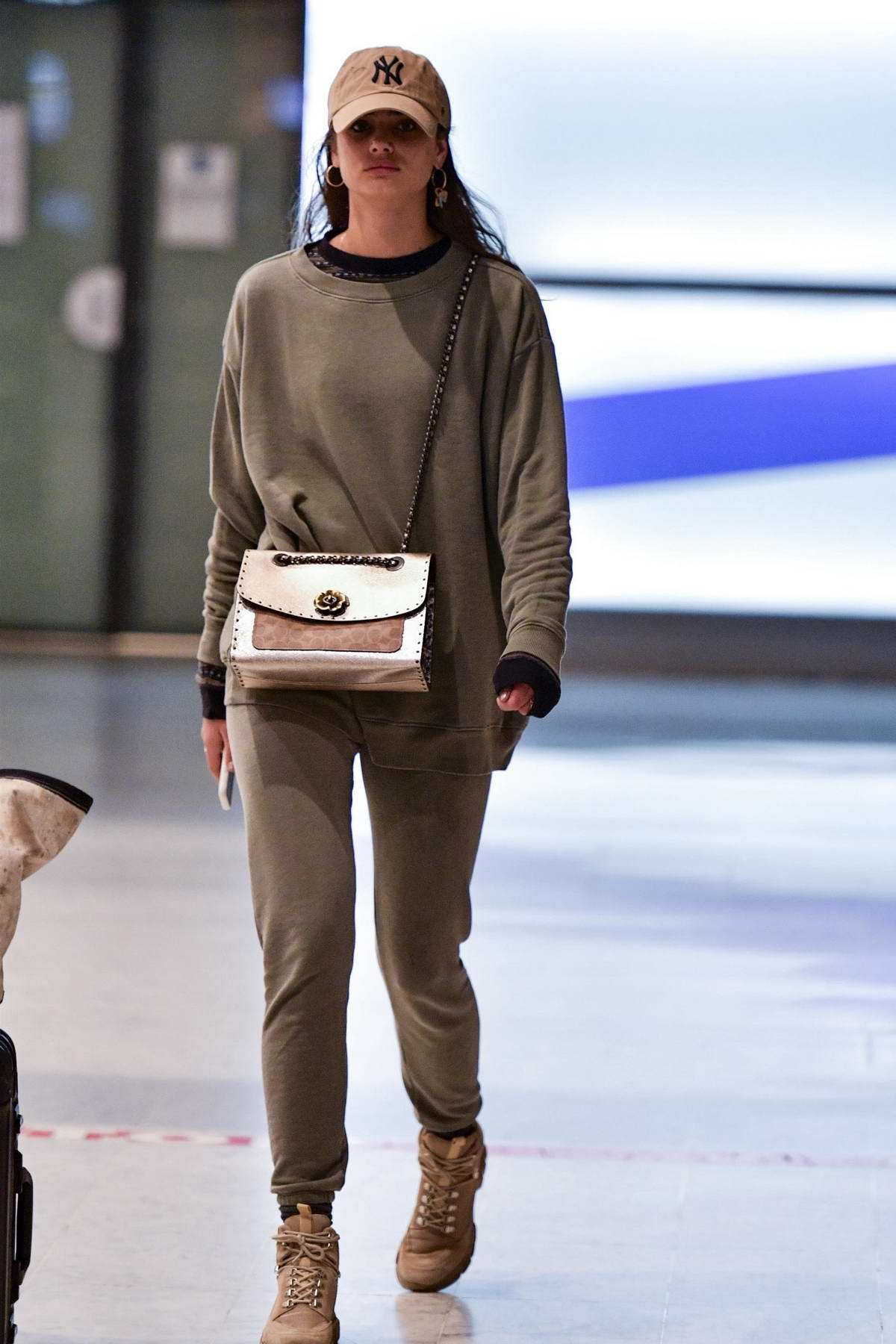 Taylor Hill keeps it casual as she arrives at Charles de Gaulle airport in Paris, France