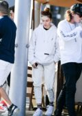 Thylane Blondeau steps out with friends wearing a white hoodie and sweatpants in Los Angeles