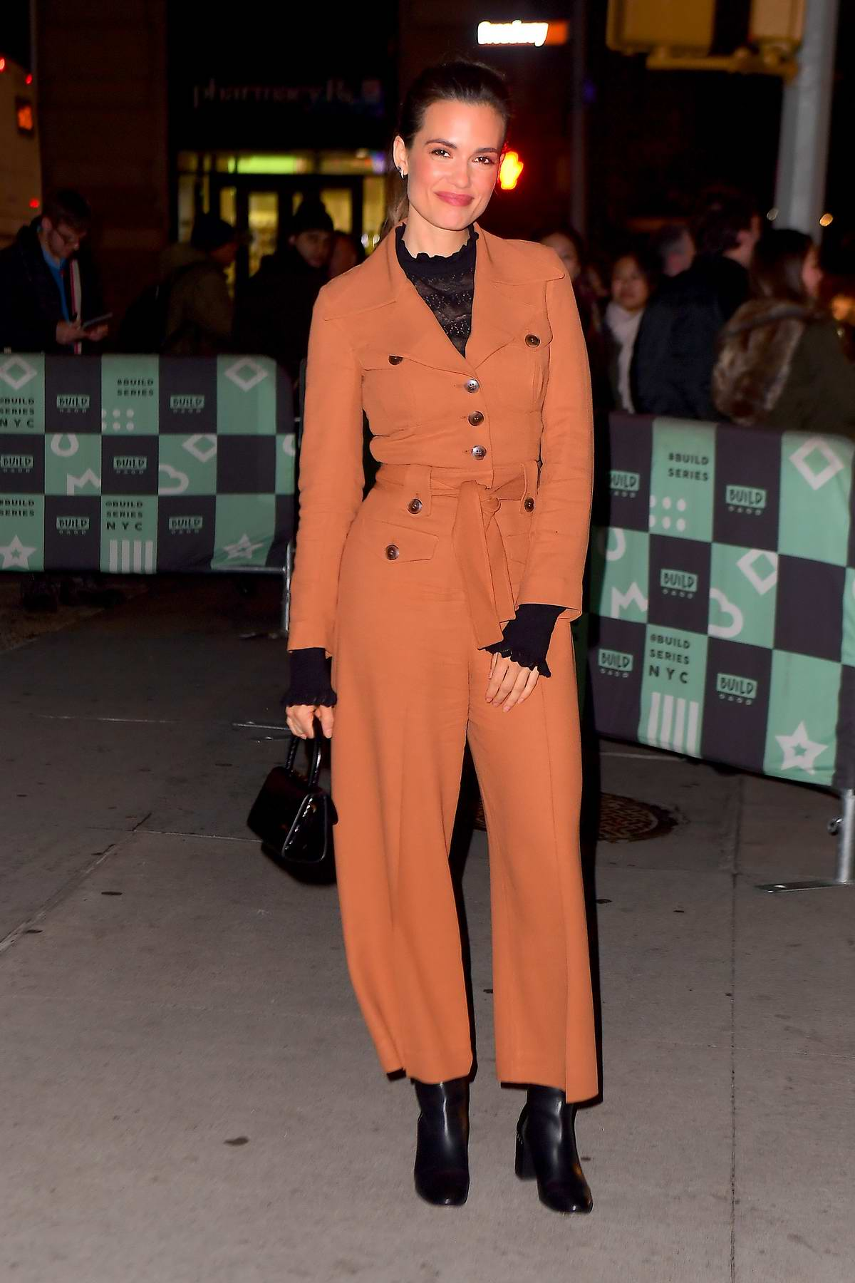 Torrey DeVitto spotted in a brown jumpsuit as she visits AOL Build Series in New York City