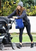 Troian Bellisario out for a stroll with her baby after some grocery shopping in Los Angeles