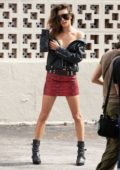 Alessandra Ambrosio poses in a black leather jacket and red skirt for Elle Italy photoshoot in Little Havana, Miami, Florida