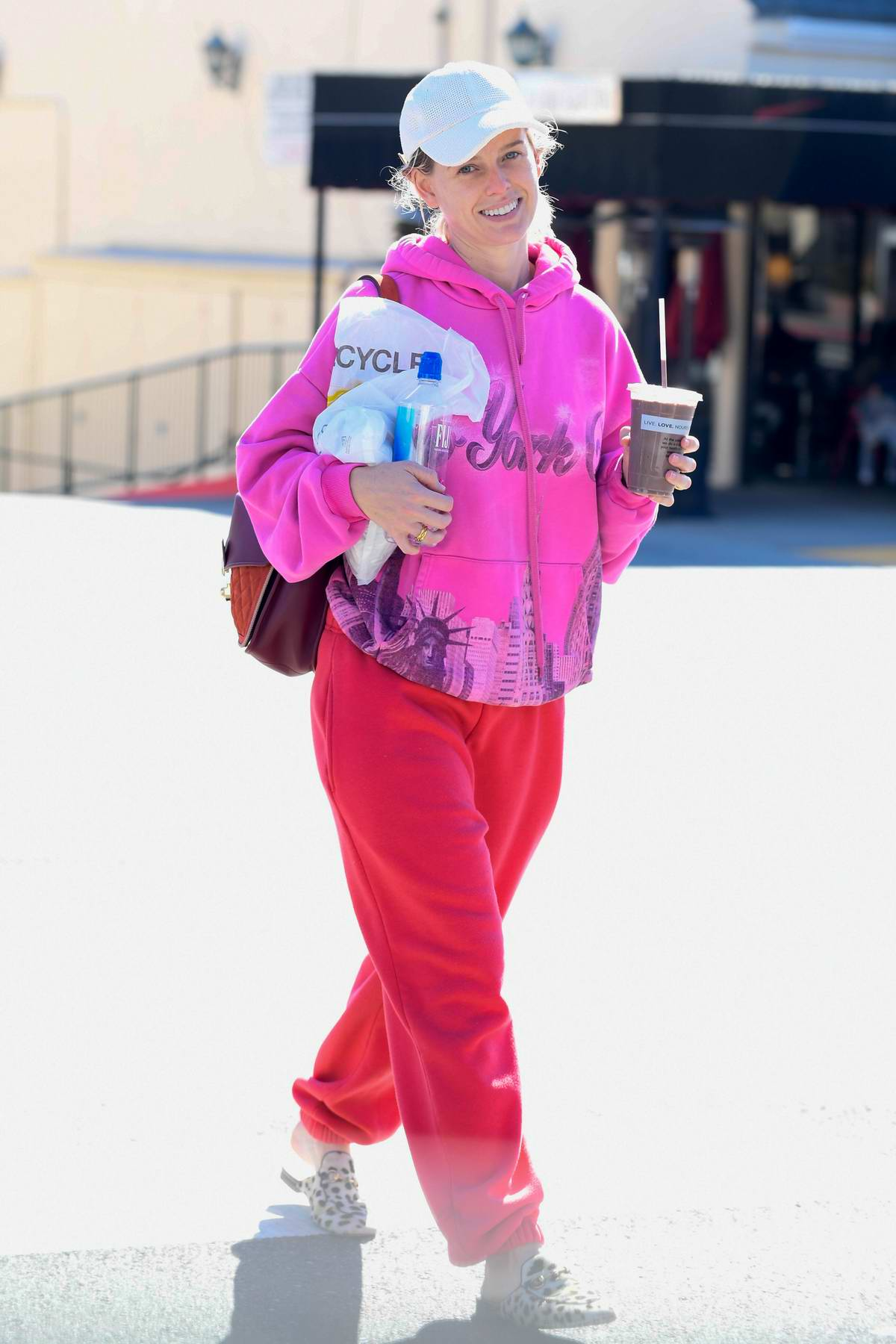 Alice Eve stands out in bright pink as she leaves a Gym in Los Angeles