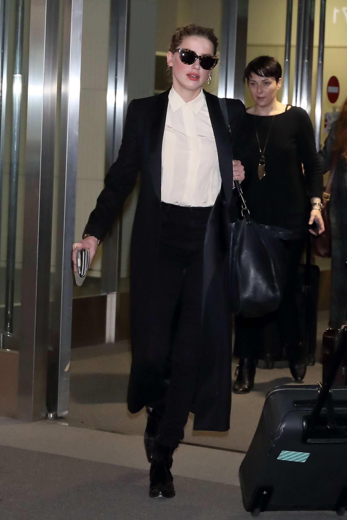 Amber Heard looks chic as she arrives at Narita International Airport in Tokyo, Japan