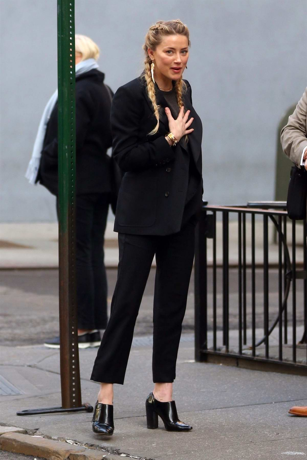 Amber Heard looks stylish in a black suit and YSL purse while out for a business meeting at Sant Ambroeus in New York City