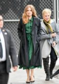 Amy Adams seen wearing black long coat with a green dress as she arrives for her appearance on Jimmy Kimmel Live in Los Angeles