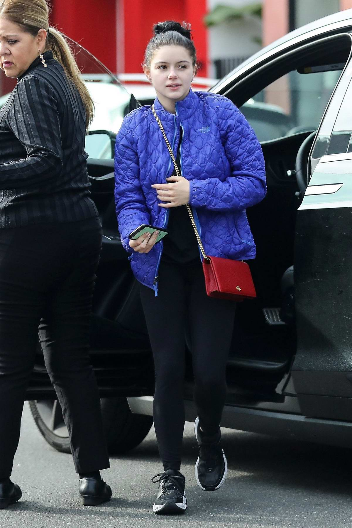 Ariel Winter dons a blue jacket and black leggings as she arrives at a hair salon in West Hollywood, Los Angeles