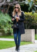 Ashley Benson enjoys an iced coffee on her way to the salon in Los Angeles