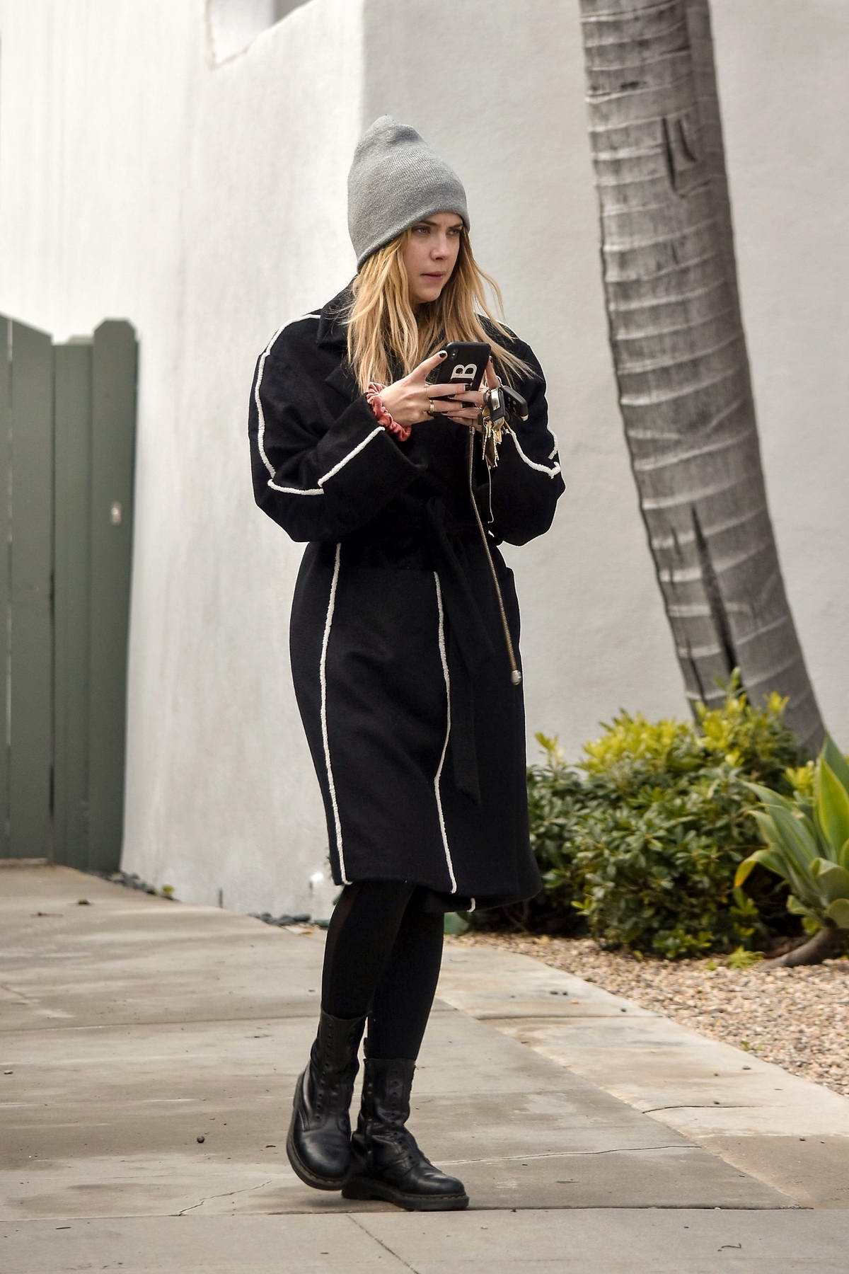Ashley Benson receives a parking ticket while visiting a friend in West Hollywood, Los Angeles