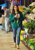 Ashley Greene sips of her soda as she steps out on a quick grocery run in Los Angeles