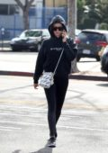 Ashley Tisdale sports a black hoodie with matching black leggings and Nike trainers as she heads to the gym in Los Angeles