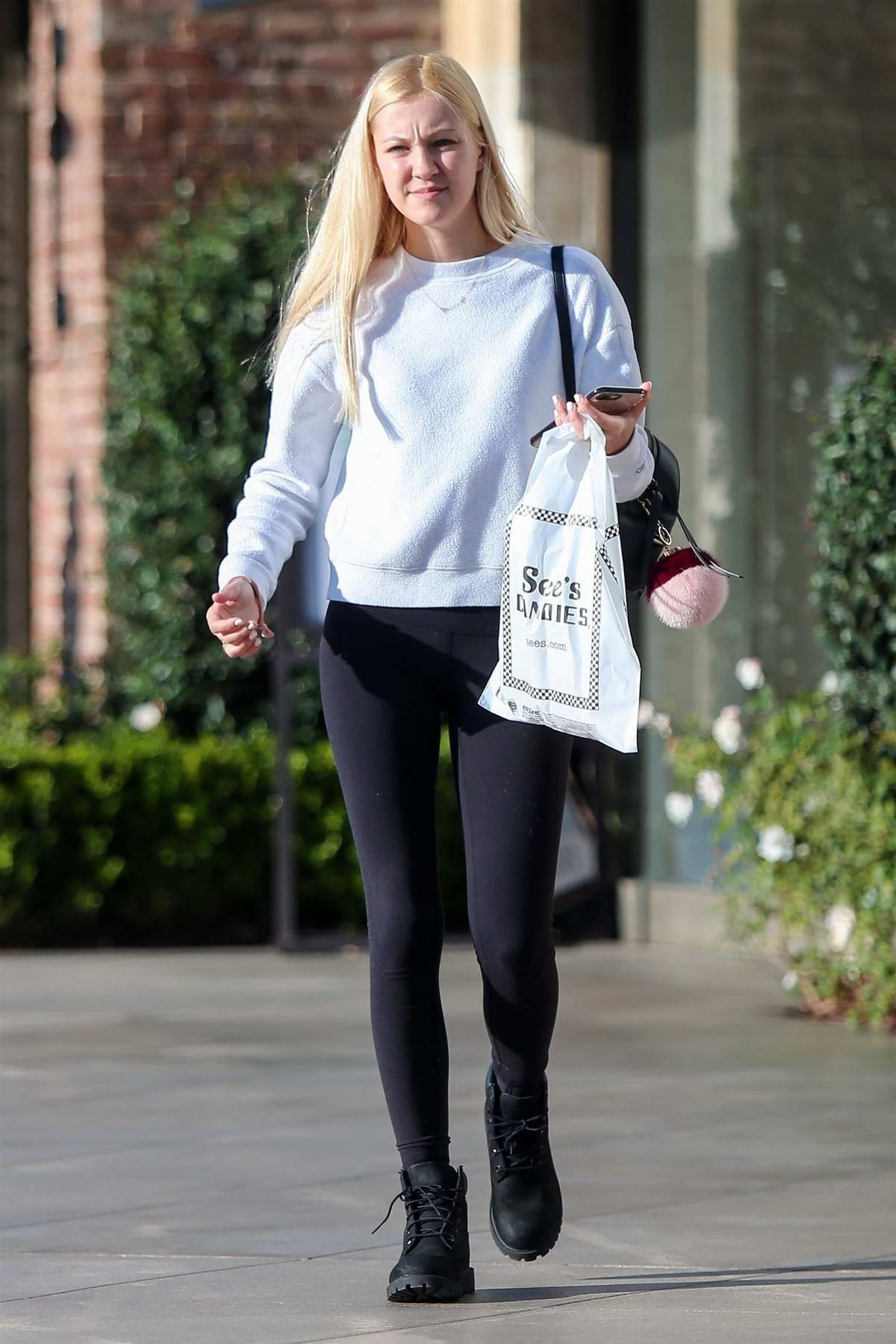 Ava Sambora keeps it casual in a white sweatshirt and black leggings while stopping by to pick up some candy at See's Candies in Los Angeles
