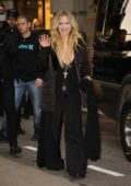 Avril Lavigne wearing all black coming out from her Hotel and greeting fans in New York City