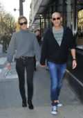 Bar Refaeli and husband Adi Ezra are all smiles as they leave l'Avenue restaurant in Paris, France