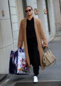 Bar Refaeli got her hands full while out shopping in Milan, Italy