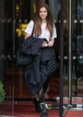 Barbara Palvin keeps it casual with a white tee and black leggings as she leaves The Royal Monceau Hotel in Paris, France