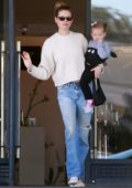 Behati Prinsloo enjoys some shopping with her daughter at Barneys New York in Beverly Hills, Los Angeles