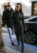 Bella Hadid arrives at Versace headquarters during Milan Fashion Week in Milan, Italy