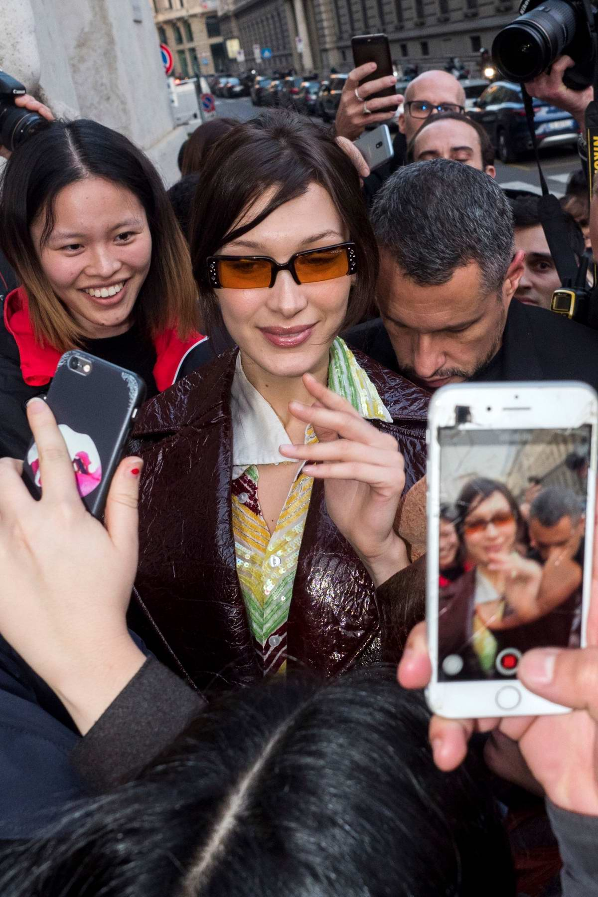 Bella Hadid greet her fans as she arrives at the Versace Fashion Show during Milan Fashion Week in Milan, Italy