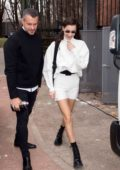 Bella Hadid rocks a white turtleneck with matching white shorts while out during Milan Fashion Week in Milan, Italy