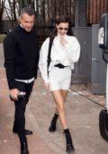 Bella Hadid rocks a white turtleneck with matching white shorts while out during Milan Fashion Week in Milan, Italy