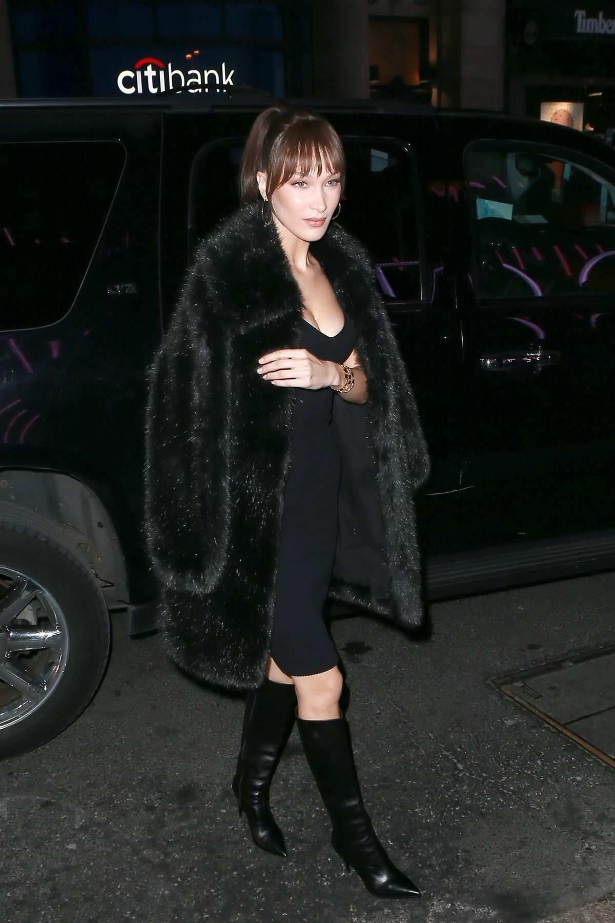 Bella Hadid rocks all black ensemble as she arrives at the 'Michael Kors x Bella Hadid Immersive Experience' in SoHo, New York City