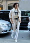 Bella Hadid rocks an 'Off White' sweater with an all white ensemble as she steps out in New York City