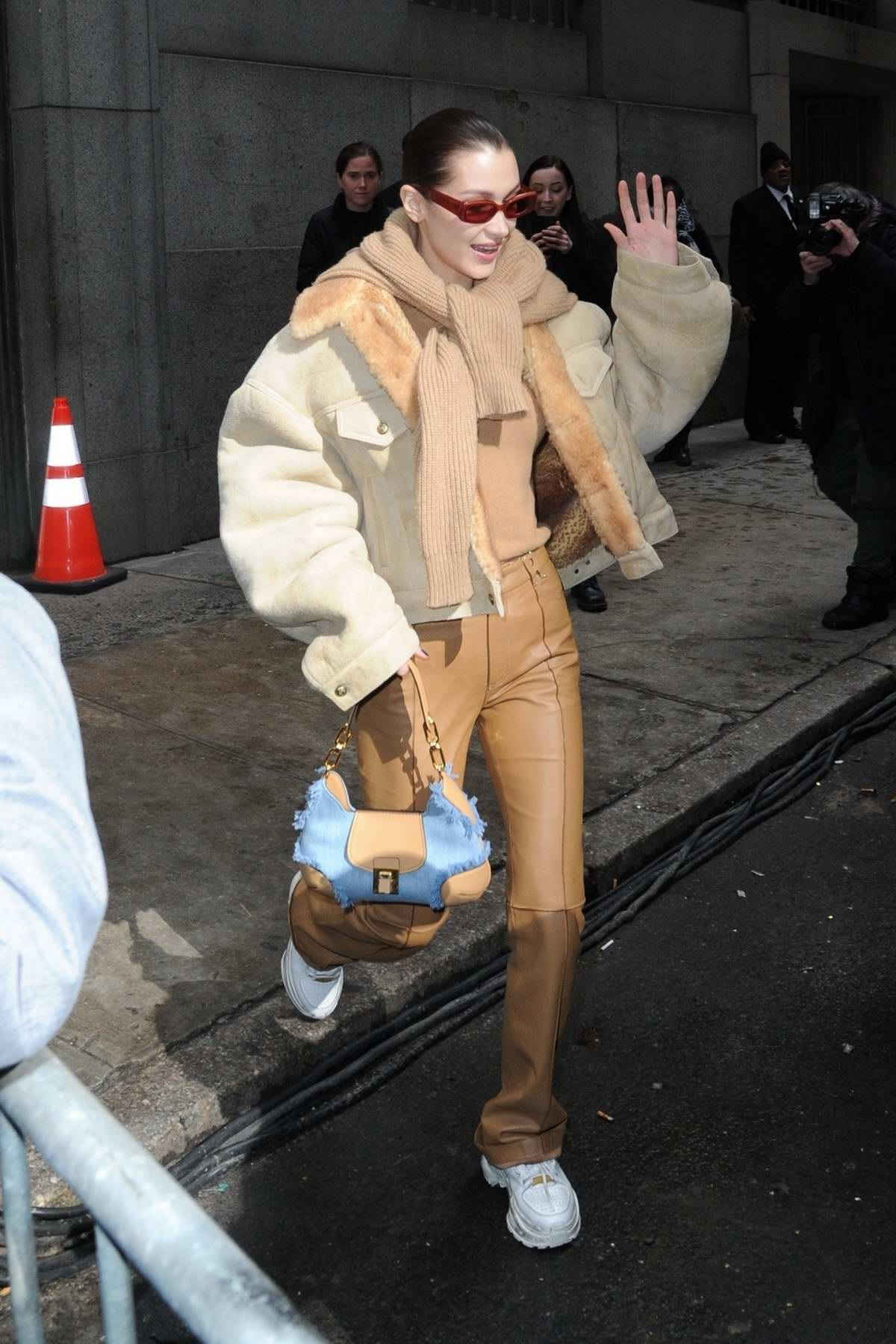 Bella Hadid shows off a trendy look while she leaves the Michael Kors Fashion Show in New York City