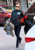 Bella Hadid wears Moncler and takes her own bags into a building during Fashion Week in New York City