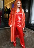 Bella Thorne rocks all orange while attending the Sally LaPointe Show during New York Fashion Week in New York City