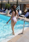 Blanca Blanco in white swimsuit at poolside at The Montage Hotel in, LA