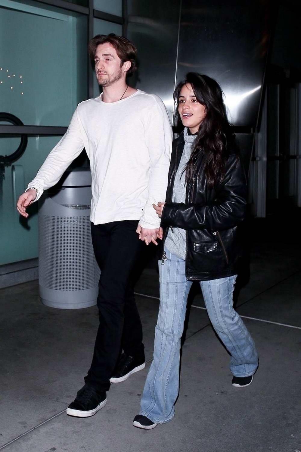 Camila Cabello and Matthew Hussey hold hands as they leave after a movie date at ArcLight Theatre in Hollywood, California